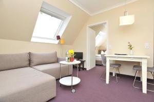 Ein Sitzbereich in der Unterkunft Apartements im Friesenhof