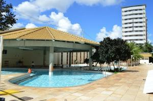 The swimming pool at or near Diroma Exclusive Flats Para Temporada
