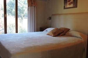 Una cama o camas en una habitación de Apart Hotel Bungalows Matute