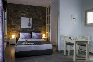 A bed or beds in a room at Aelia Studios