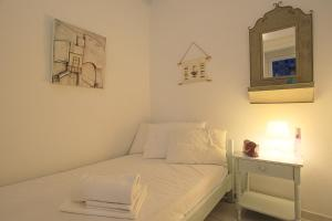 A bed or beds in a room at Estiades Apartment