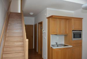 Kuchyň nebo kuchyňský kout v ubytování Apartmán Javor