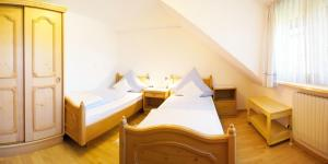 Ein Bett oder Betten in einem Zimmer der Unterkunft Haus Hilgarth