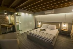 A bed or beds in a room at Eulogia Casa