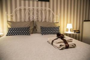Ein Bett oder Betten in einem Zimmer der Unterkunft Piazza Roma Rooms