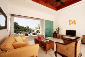 A seating area at Kamala Luxury Seaview with Private Pool