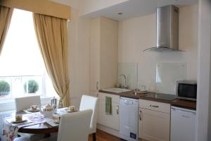 A kitchen or kitchenette at Pier View Self Catering Luxury Apartments