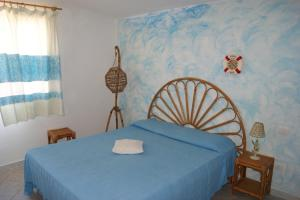 A bed or beds in a room at Borgo Marino Badesi