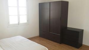 Ein Bett oder Betten in einem Zimmer der Unterkunft Gibraltar City Apartment