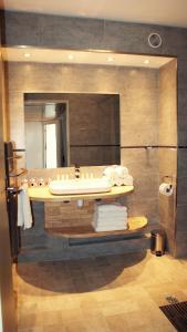 Salle de bains dans l'établissement ApartHotel Sainte-Marthe