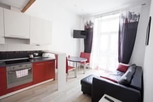 A kitchen or kitchenette at Rent-Apart City Center Lodz