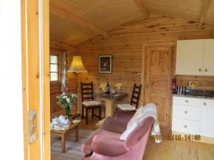 A seating area at Polgwedhen Lodge