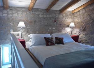 Vuode tai vuoteita majoituspaikassa Critamo Cottage