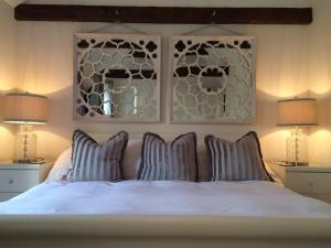 A bed or beds in a room at The Cottages Scampton