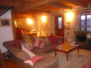 A seating area at Le Cottage