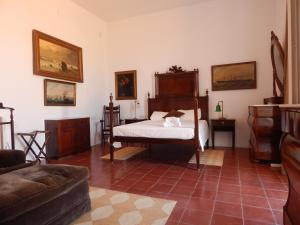 A bed or beds in a room at Villa Balcón del Mar