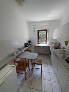 Küche/Küchenzeile in der Unterkunft Ferienhaus Am Walde