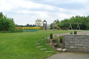 Een tuin van Fitting Landsbyferie Apartments