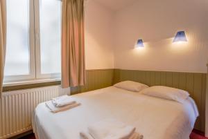 Un ou plusieurs lits dans un hébergement de l'établissement Residentie Sweetnest