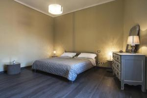 A bed or beds in a room at La Pulce Argentata