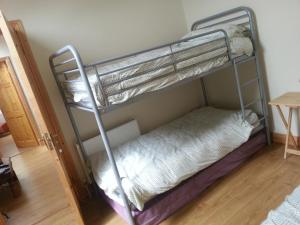 A bunk bed or bunk beds in a room at Bathog Apartments