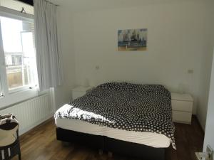 A bed or beds in a room at Apartment Beyaert