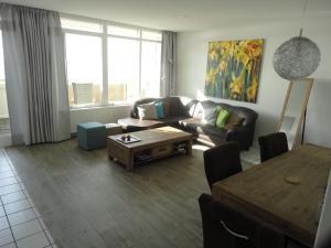 A seating area at Apartment Beyaert
