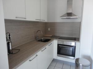 A kitchen or kitchenette at Apartment Beyaert
