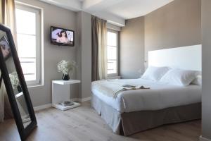 Säng eller sängar i ett rum på Rambla 102