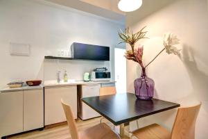 A kitchen or kitchenette at D.Z Complex
