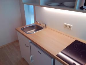 A kitchen or kitchenette at OREL Apartments