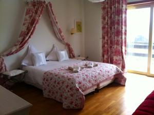 Ein Bett oder Betten in einem Zimmer der Unterkunft Villa Du Lion D'or
