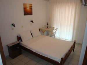 A bed or beds in a room at Filaktos Studios