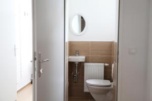 Vonios kambarys apgyvendinimo įstaigoje Helle Wohnung - direkt am Augarten