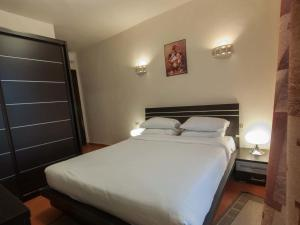 A bed or beds in a room at Porto Holidays Sokhna Apartments - Pyramids