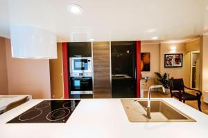A kitchen or kitchenette at Suites One