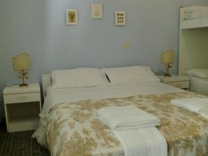 A bed or beds in a room at Residence Marche - Residenza Ecologica