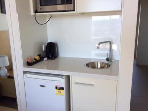 A kitchen or kitchenette at PA Apartments