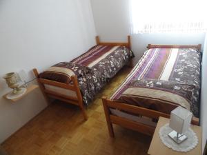 Postelja oz. postelje v sobi nastanitve Apartma Skubin