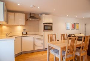 A kitchen or kitchenette at My-Canning Street Apartments
