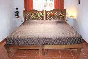 A bed or beds in a room at Residence Mexico y Nubes