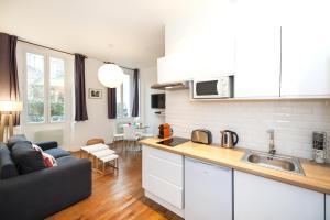 Cuisine ou kitchenette dans l'établissement Pick a Flat - Residence Mornay