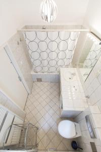 Ein Badezimmer in der Unterkunft Carlton Suites