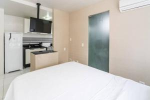 A bed or beds in a room at Classic Golden Point - Boa Viagem