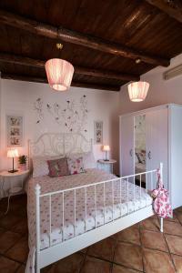 A bed or beds in a room at Attico Finocchiaro