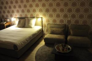 Een bed of bedden in een kamer bij Schopenhauer
