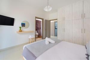 A bed or beds in a room at Greatland Villas
