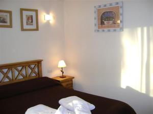 A bed or beds in a room at Carilo Princess
