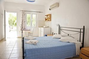 מיטה או מיטות בחדר ב-Evagelia's Place