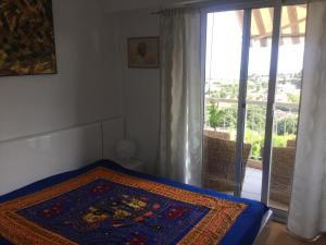 Ein Bett oder Betten in einem Zimmer der Unterkunft Les Argonautes